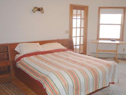 Master bedroom with queen, full bathroom, TV & porch access
