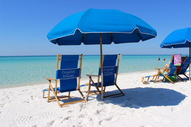 Sit in the shade of your complimentary seasonal beach setup.