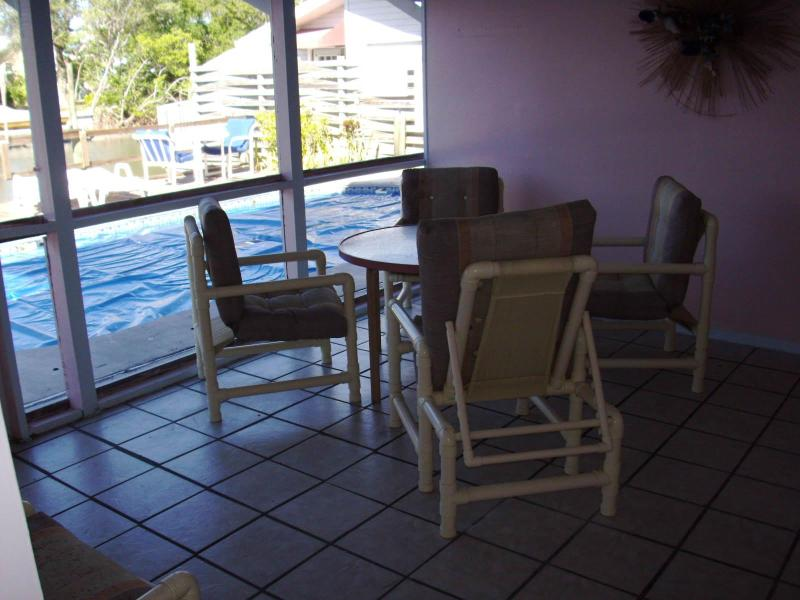 Screened Lanai overlooking pool, dock, & canal