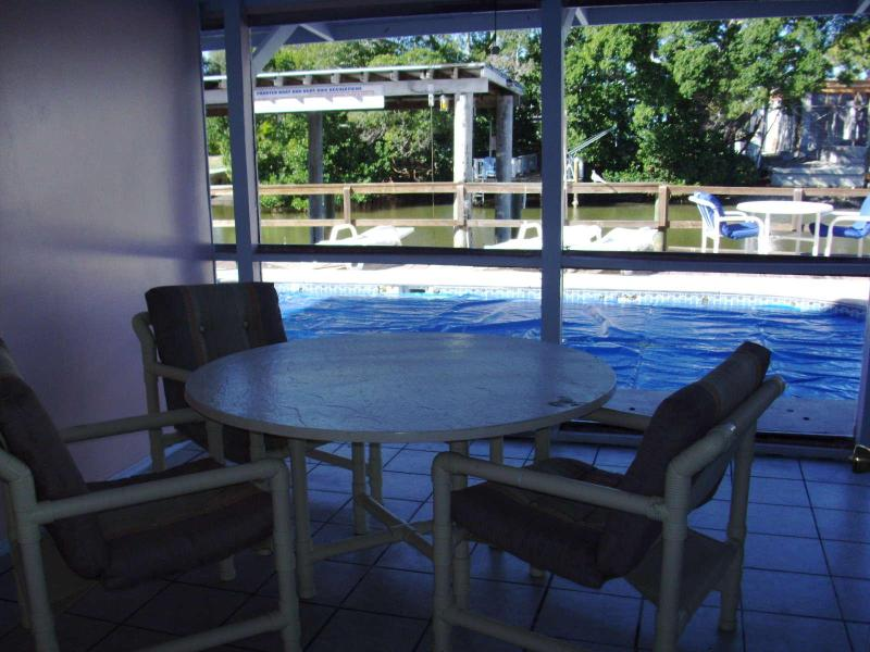 lanai (screened-in) overlooking the pool, dock, & canal