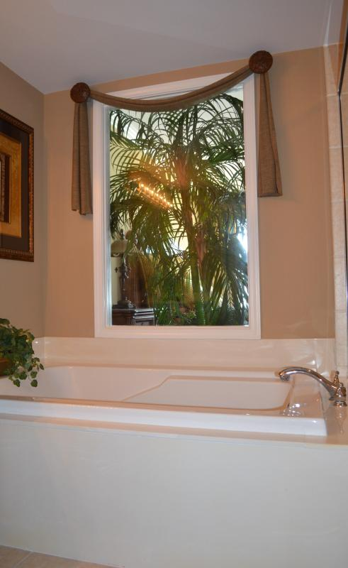 Master bathroom with Roman tub, shower and double sinks