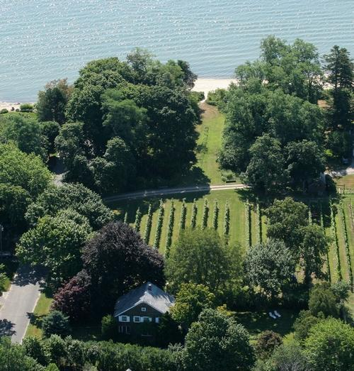 Aerial view of the Old Bay Home farmhouse and beach