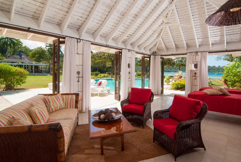 The Cottage living room includes 2 chaise lounges that are actually twin mattress for 2 additional guests, enabling Noble House to sleep 10 guests comfortably ... each pair of guests with a private bathroom.