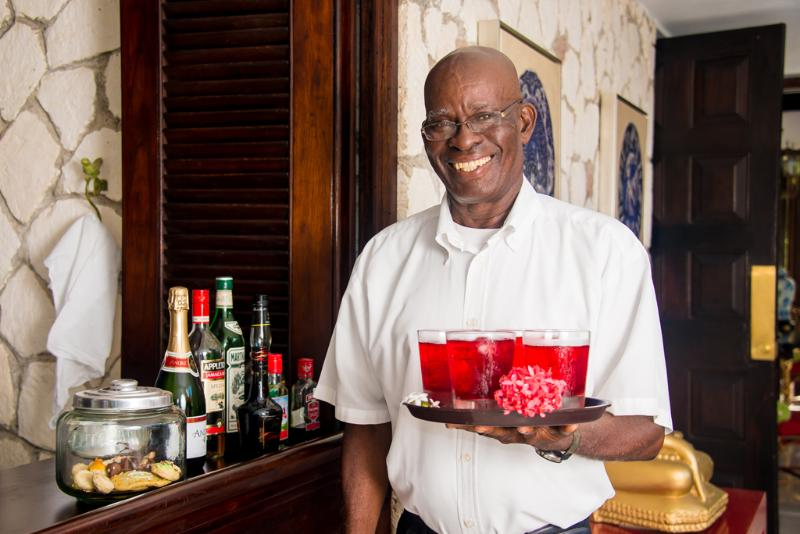 FOOD and DRINK!  Everyone craves the extraordinary food and service that come with a villa vacation.  Your arrival starts with a welcome drink offered by longtime butler, Rodrick.  Many more drinks to come.