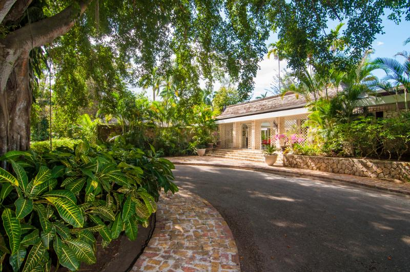THE GROUNDS OF NOBLE HOUSE  Enter its circular driveway in the shade of a 100-year-old ficus tree.