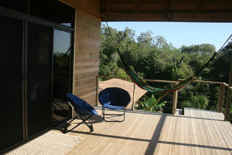 deck with forest and ocean view