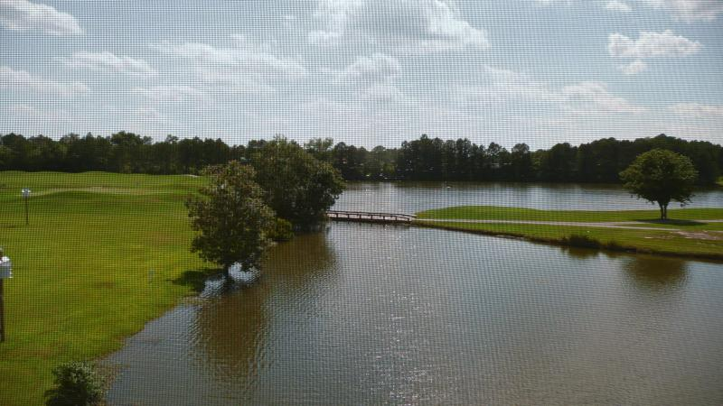 View of golf course & lake from porch