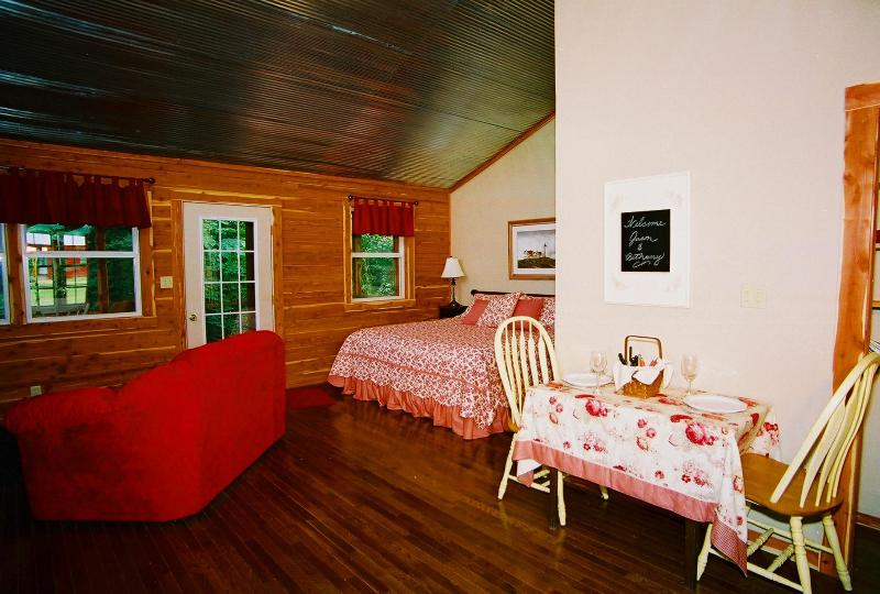 Woodcreek Cabin interior - dining table for 2, king bed, love seat