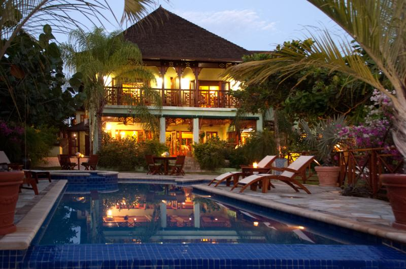 WHISPERING WATERS is stunning 7-bedroom private villa with 12,000 square feet of living space ...