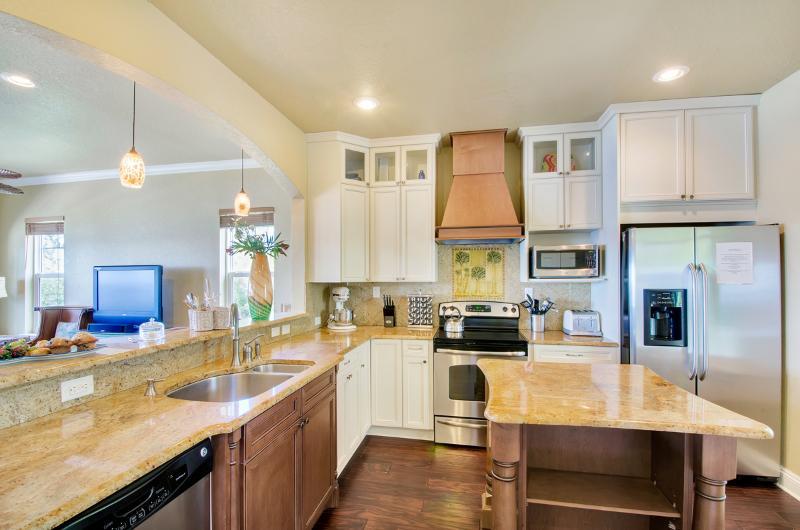 Kitchen has nice appliances, spices, high-end pans/pots