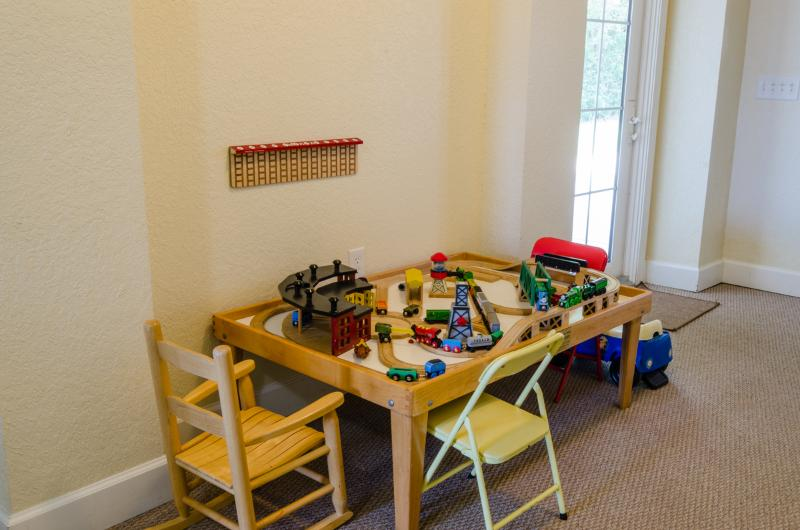 Game area has train table for little ones