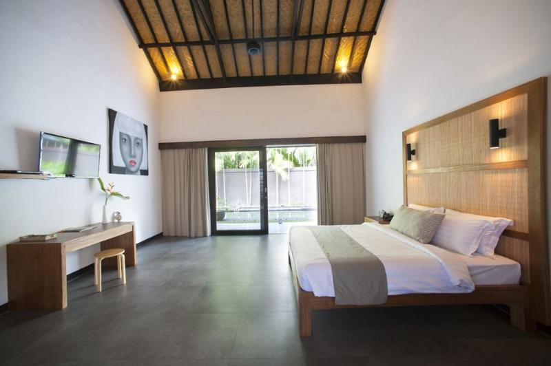 very spacious and comfortable bedrooms with large glass sliding doors to bring the outdoors in.
