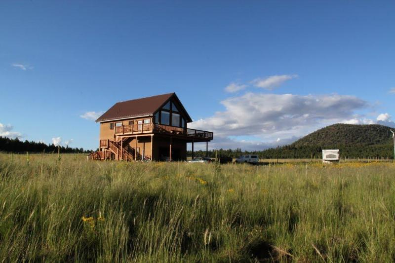 Surrounded by elk grass and open space and facing a glorious mountain view.