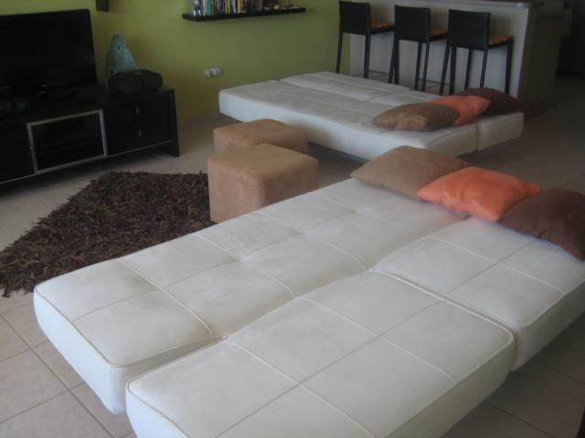 The two click-it sofas make into comfortable full beds