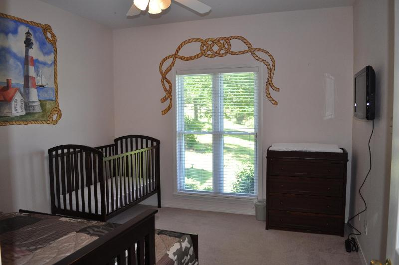 Upstairs bedroom with a captain's twin bed (2) and a crib
