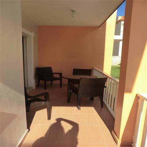 Balcony with table and 4 chairs