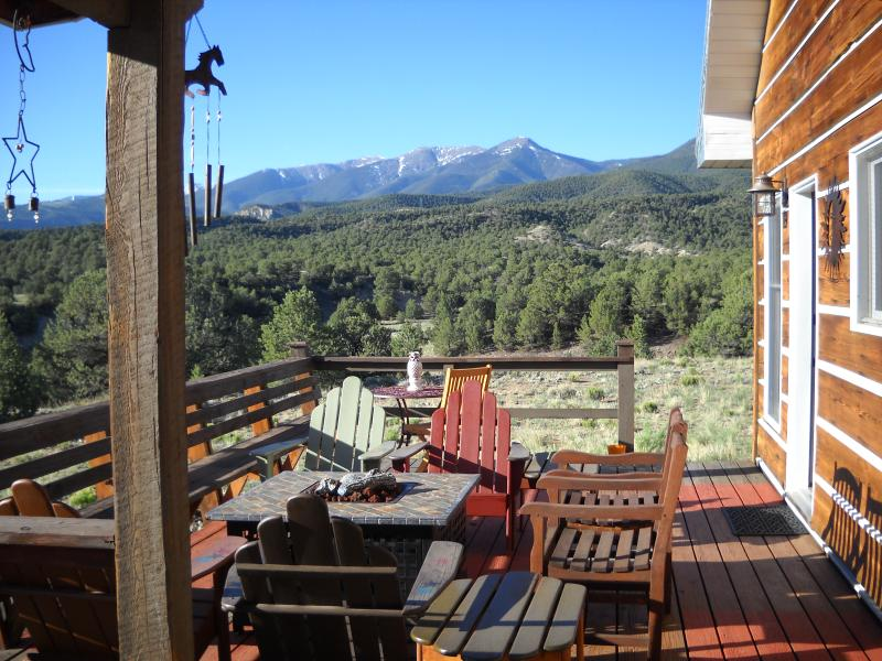 The sumptuous back deck with gas fire pit, ample seating & unobstructed views of Methodist Mountain.