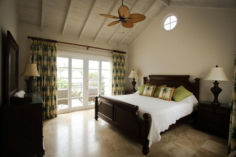 master bed suite with balcony and sea view, double vanitory unit, shower,  bath and walk in wardrobe