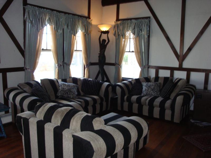 Living Room w/piano & fireplace