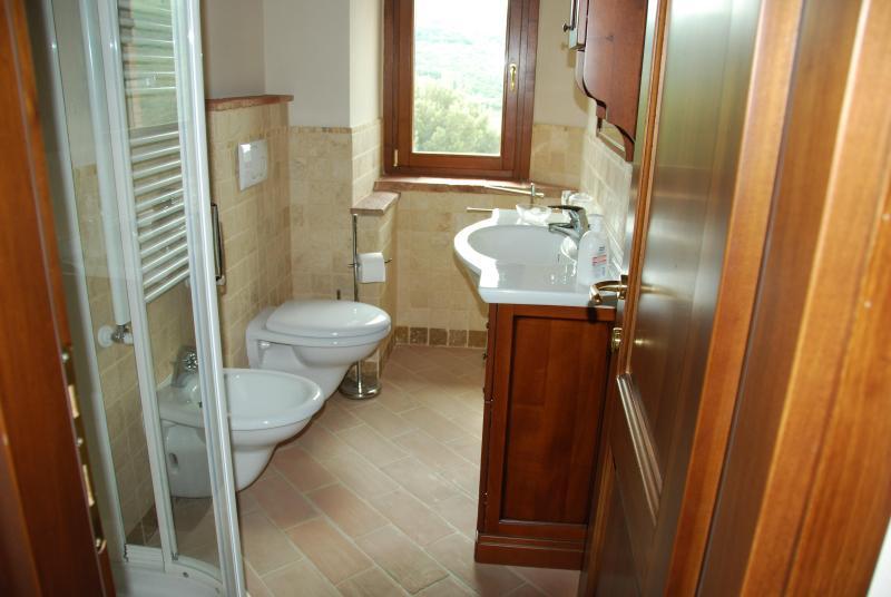 2 bathrooms-travertine tiled