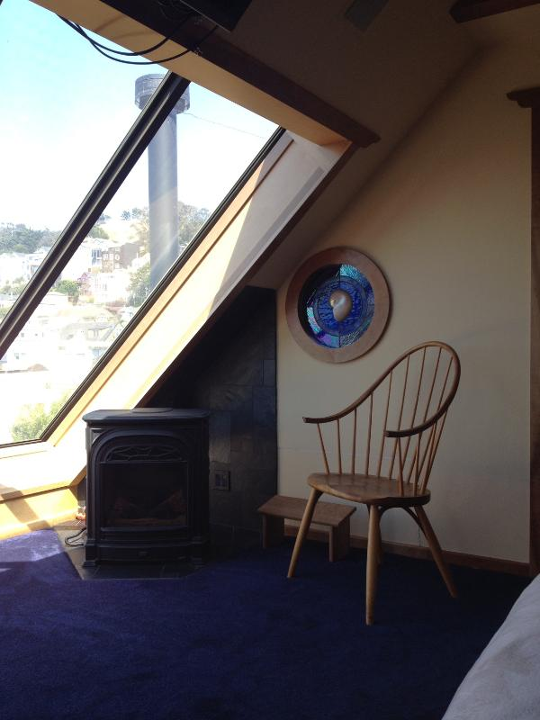 Spindle chair and fireplace looking out at sweeping views of Noe Valley, Bernal Heights and more.