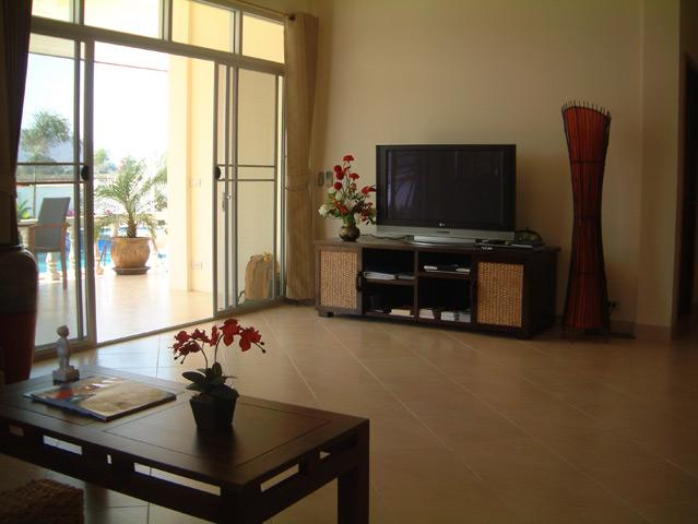Living room with 42'HD TV with satellite receiver and DVD player