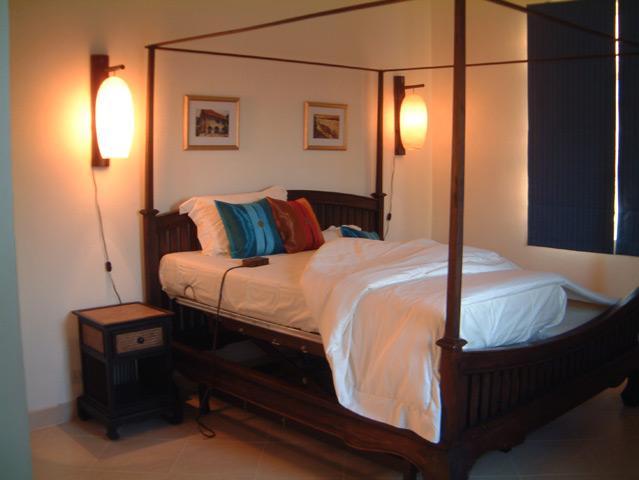 Master bedroom. King bed, integrated hospital bed. Electric adjustable high/low, headrest, footrest,