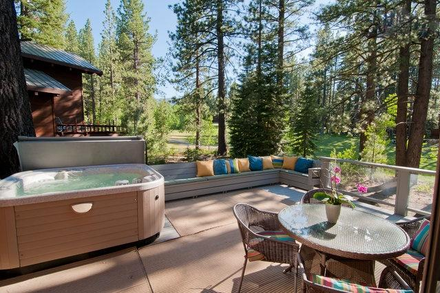 Jacuzzi on large wrap-around deck overlooking golf course