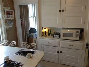 Kitchen. Built-In Hutch. Microwave. Entrance to Laundry.