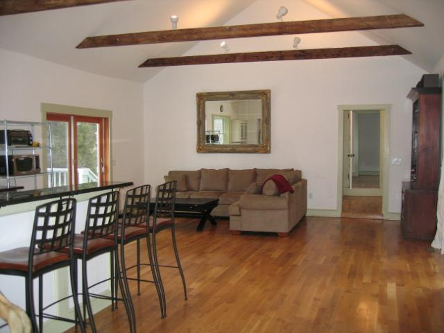 Family room, tv and DVD player. Opens to large deck with table, chairs and grill.