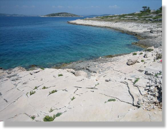 one of our island's hidden bays with large smooth rocks (nice to lay your towel on) and white gravel