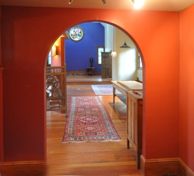 Entrance into sanctuary, view of stained glass in back wall.