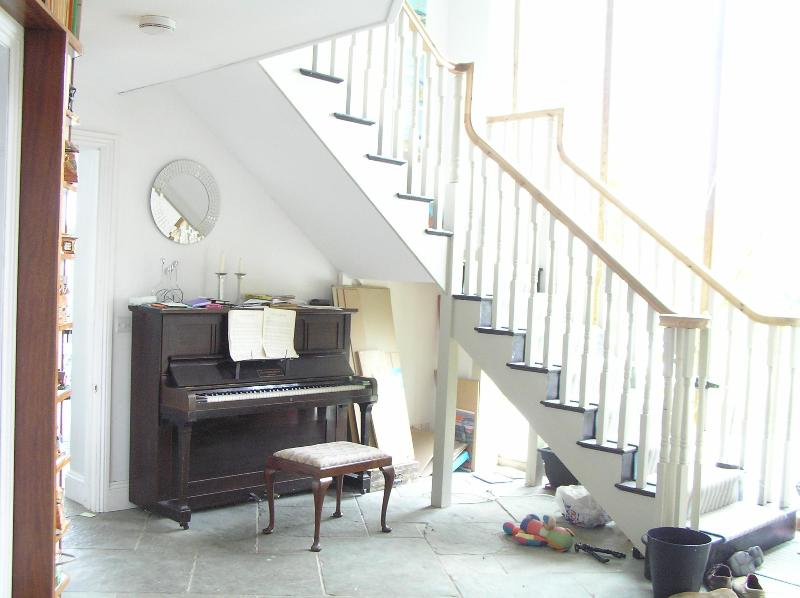 Hall, stairs and piano