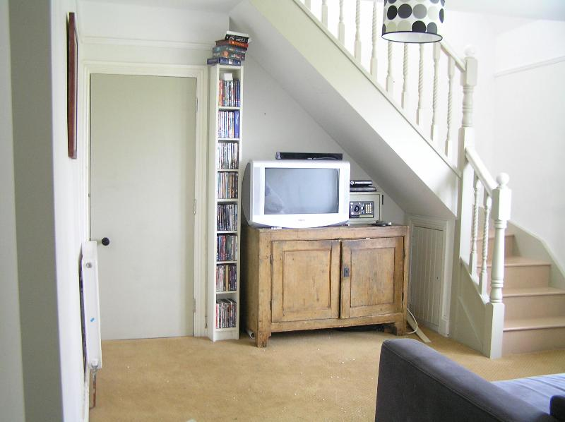 TV room and stairs to attic bedrooms