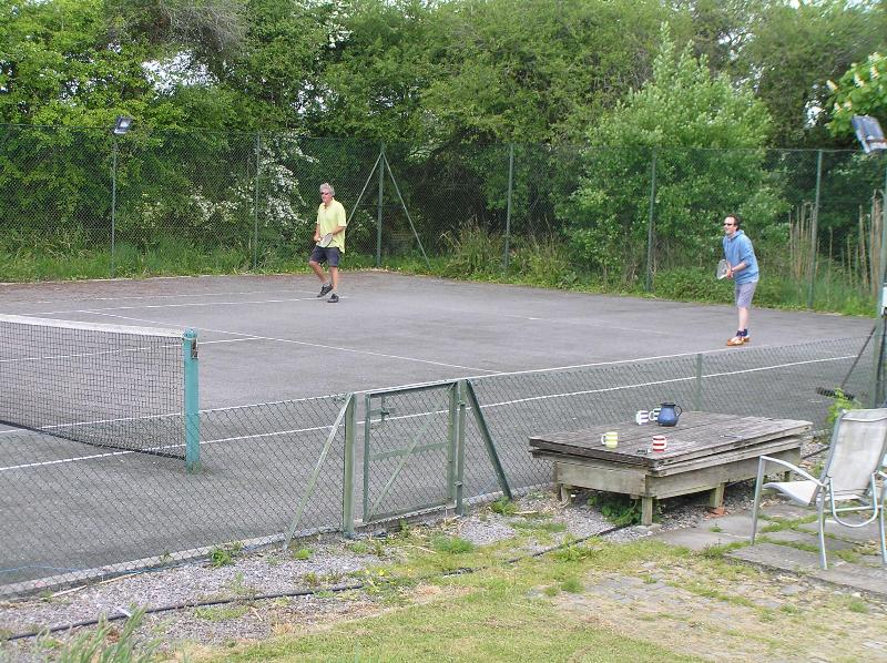 Tennis court with floodlights