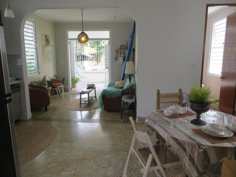 First floor living room with main entrance double doors towards large porch.