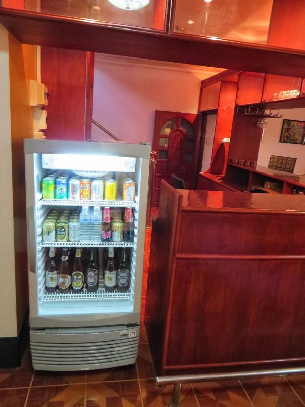 Self service drinks fridge and bar