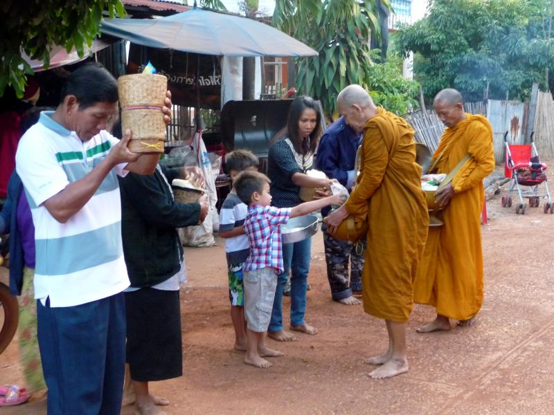 Giving alms to the monks every morning