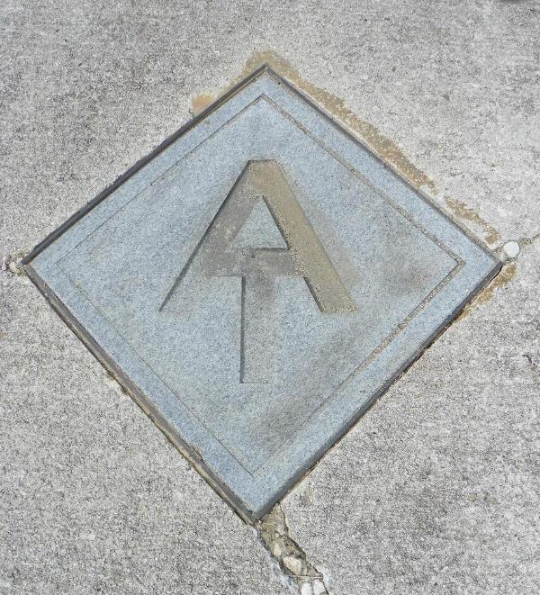 Hot Spring sidewalk embeded with proff you are hiking the Appalachian Trail