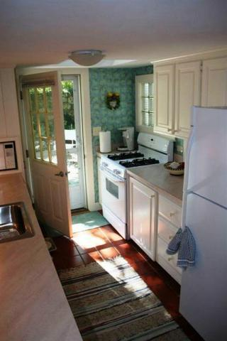 Fully updated galley kitchen with door to Patio