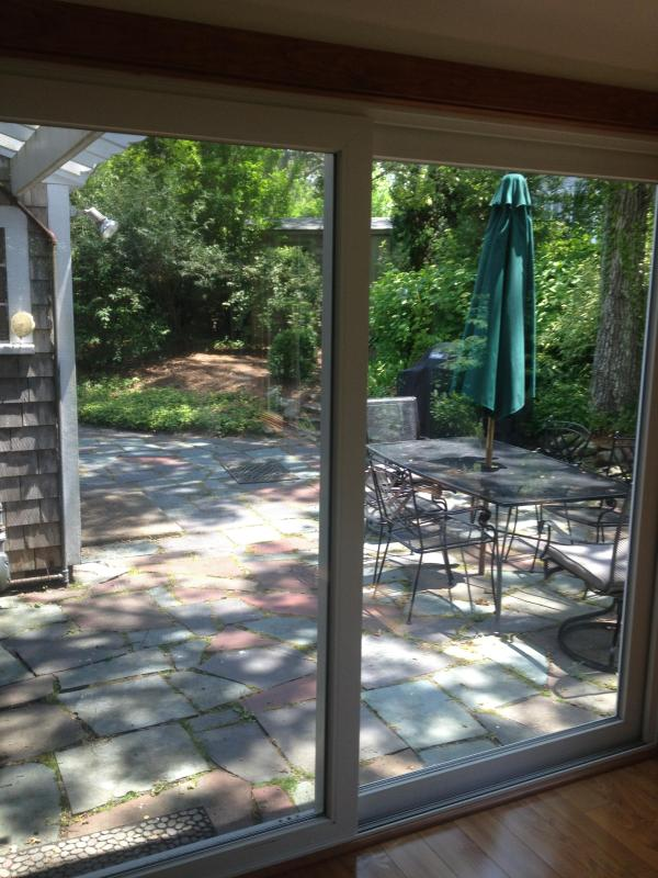 Patio includes dining area and gas grill for entertaining