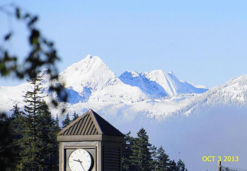 Whistler Mountain early morning - taken from Blackcomb Way with clocktower in foreground.