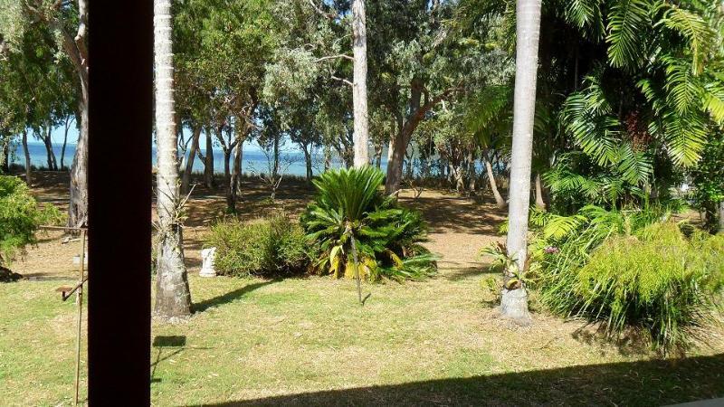 standing on front verandah towards beach