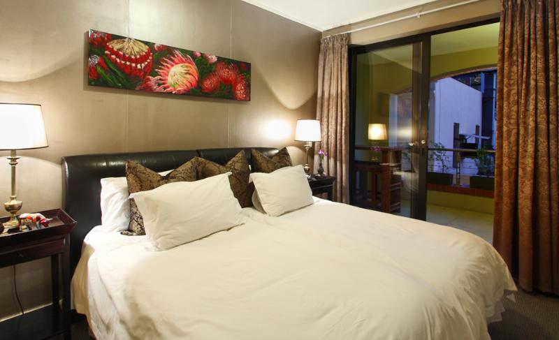 Spacious bedroom, great view of Table Mountain via the balcony