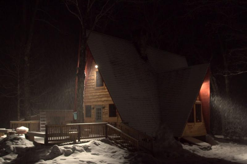 Great Brook Cottage in a winter storm at night