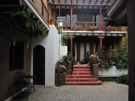 Cobblestone courtyard and garden and studio entrances
