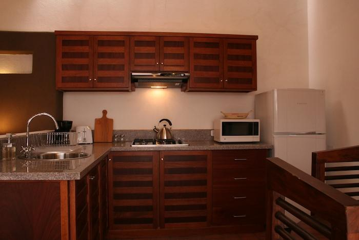 Kitchen, fully equipped with recessed lighting