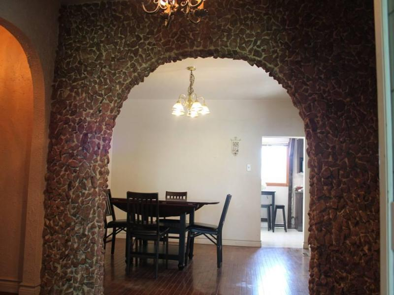 Dinning room with spanish cobble stone wall