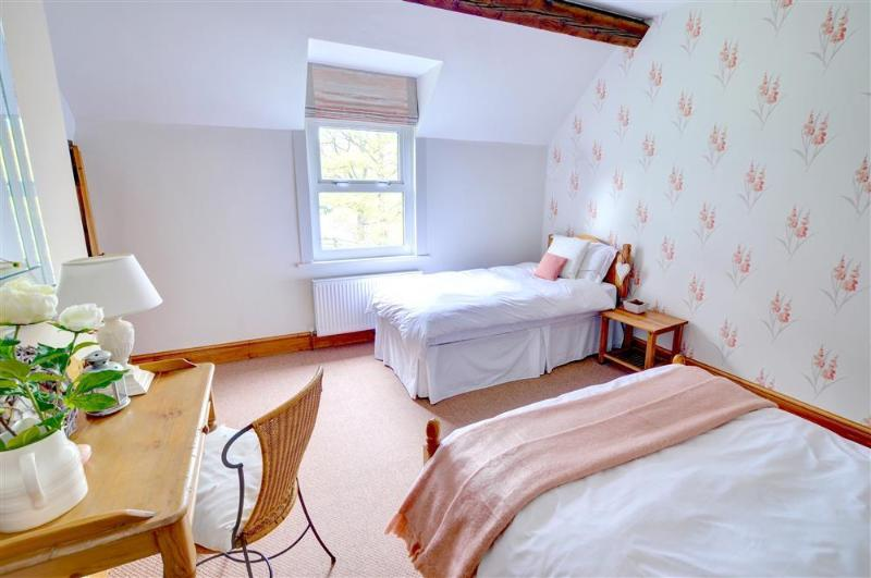 The spacious second bedrooms is a family room with a double and a single bed