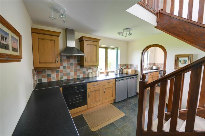 The high quality kitchen has very smart units and is fully-equipped